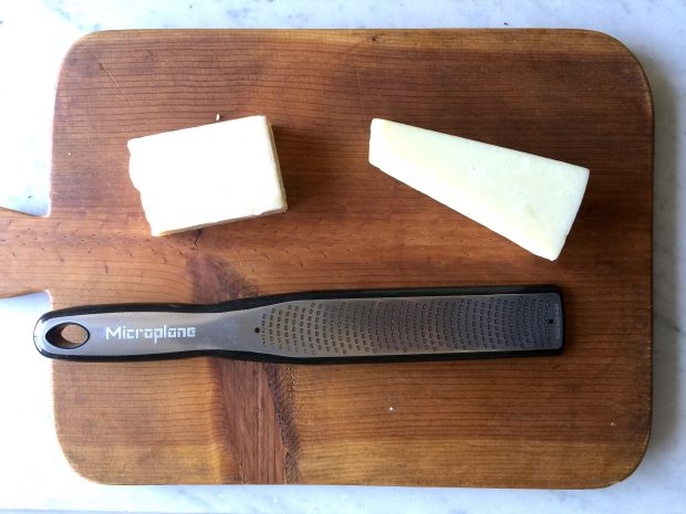 Start by using a fine toothed grater to shred the cheese.